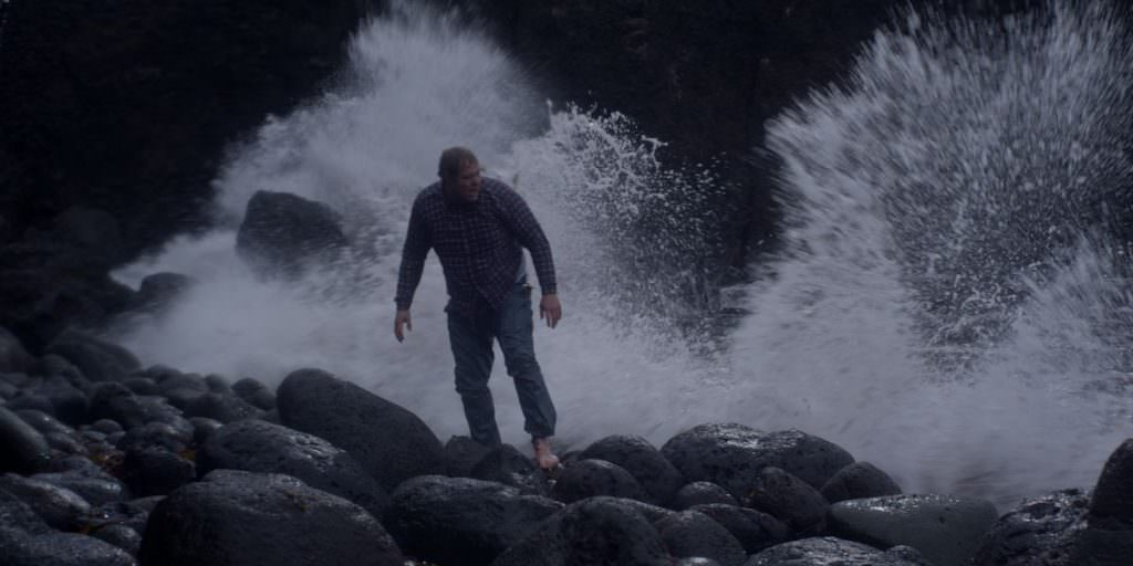 Ólafur Darri Ólafsson as Gulli, the lone survivor of the shipwrecked Brecki, shoeless and freezing after washing up on a rocky shore. Photo courtesy Balthasar Kormákur