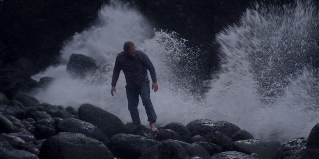 Ólafur Darri Ólafsson as Gulli, the lone survivor of the shipwrecked Brecki, shoeless and freezing after washing up on a rocky shore. Photo courtesy Balthasar Kormákur