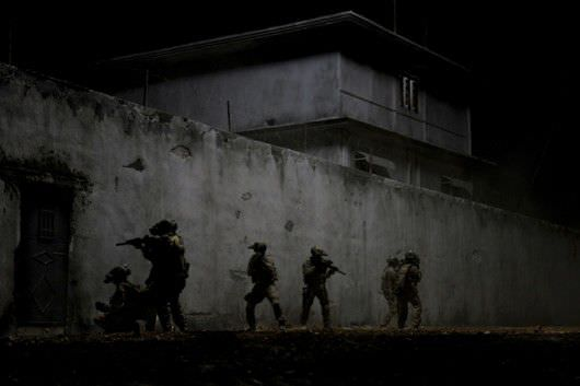In the darkest hour of the night, elite Navy SEALs raid Osama Bin Laden's compound in Columbia Pictures'  ultra realistic new thriller from director Kathryn Bigelow, about the greatest manhunt in history, ZERO DARK THIRTY. Courtesy Sony Pictures