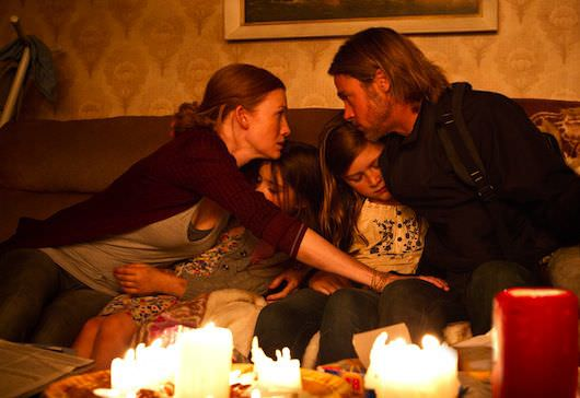 Left to right: Mireille Enos is Karin Lane, Sterling Jerins is Constance Lane, Abigail Hargrove is Rachel Lane, and Brad Pitt is Gerry Lane in WORLD WAR Z, from Paramount Pictures and Skydance Productions in association with Hemisphere Media Capital and GK Films.