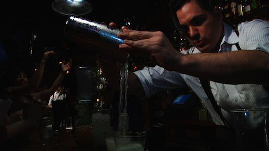 Sasha Petraske having a busy night at the bar. Courtesy Doug Tirola