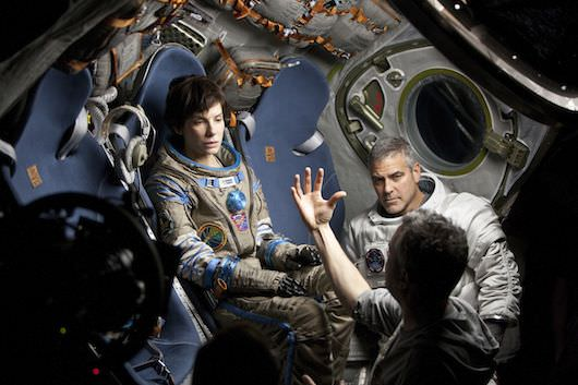 Sandra Bullock, George Clooney and director Alfonso Cuarón. Courtesy Warner Bros. Pictures