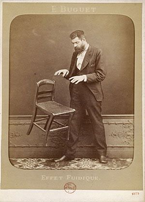 Spirit photography hoaxer Édouard Isidore Buguet[19] (1840-1901) of France fakes telekinesis in this 1875 cabinet card photograph titled Fluidic Effect.