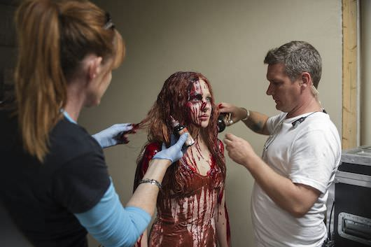 Make up artist Jordan Samuel (right) with hairdresser Cliona Furey (left) and Chloe Moretz on the set of Metro-Goldwyn-Mayer Pictures and Screen Gems' CARRIE.