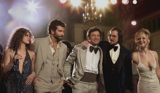 (l to r) Amy Adams, Bradley Cooper, Jeremy Renner, Christian Bale and Jennifer Lawrence in Columbia Pictures' AMERICAN HUSTLE. (Amy Adams dress: made for film, jewelry, shoes: vintage / Bradley Cooper suit, shirt: made for film / Jeremy Renner suit: made for film, tie, shirt: vintage / Christian Bale suit: made for film, tie, shirt: vintage / Jessica Lawrence dress: made for film, jewelry, shoes: vintage)