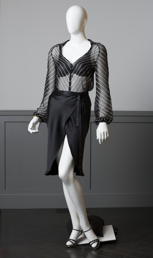 Black and White chevron shirt with black satin skirt, worn by Amy Adams for scene at the FBI. Both pieces designed and made for the film.  Vintage Charles Jourdan pumps. Period Lingerie (custom-made for the film by Maidenform). Costume design by Michael Wilkinson. Courtesy Columbia Pictures.