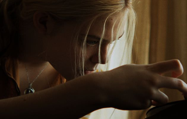 Elle Fanning as Amy-Jo Albany, playing a beloved jazz record. Courtesy Sundance Film Festival.