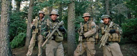 "(L to R) Michael Murphy (TAYLOR KITSCH), Marcus Luttrell (MARK WAHLBERG), Matt ""Axe"" Axelson (BEN FOSTER) and Danny Dietz (EMILE HIRSCH) in ""Lone Survivor."" Courtesy Universal Pictures"