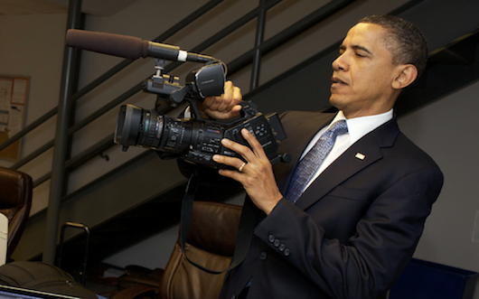 POTUS handling a new digital camera.