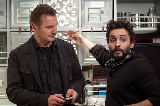 Liam Neeson listens to director Jaume Collet-Serra on the incredibly cramped set of 'Non-Stop.' Courtesy Universal Pictures.