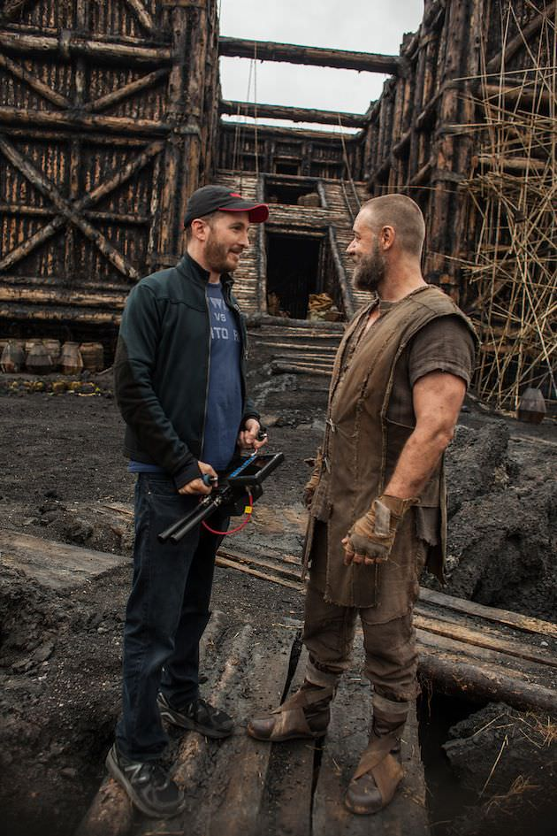 Darren Aronofsky and Russell Crowe on the set at Planting Fields Arborteum State Historic Park in Oyster Bay, New York. Courtesy Paramount Pictures.