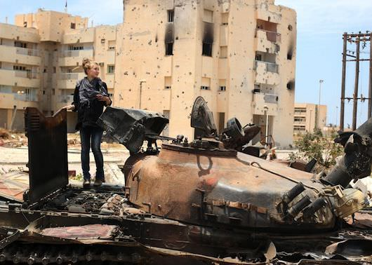 Checking-out-bombed-tank-in-Libday-copy.jpg