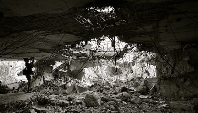 Filming a former Gaddafi home after NATO bombed the compound inside of Tripoli, Libya.