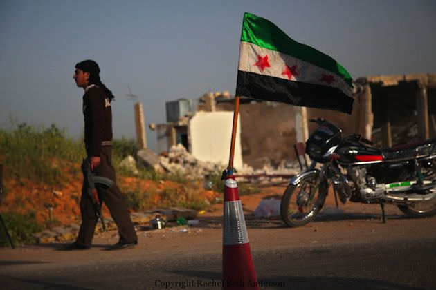 An FSA guard stands outside a checkpoint in the countryside of Idlib, Syria.