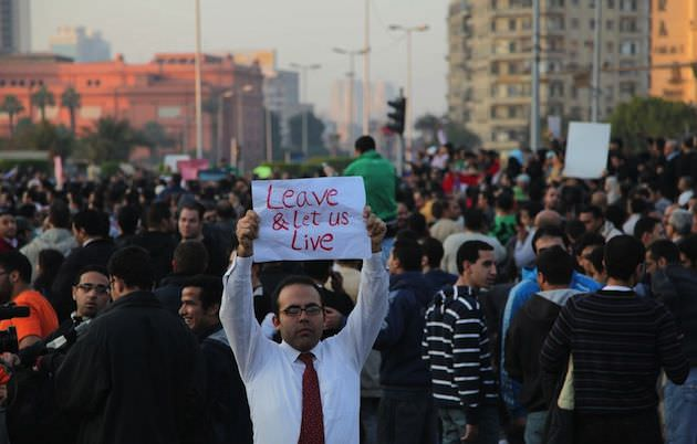 One Egyptian man holds a sign for the outside world to see exactly what the protestors in Egypt felt they wanted at that time…many thought have changed now with hindsight. Photo by Rachel Beth Anderson.