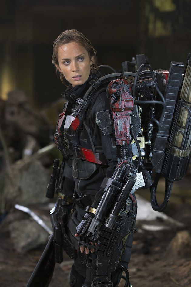 Chopper blade and splashes of red make Rita's suit stand out. Courtesy Warner Bros. Pictures.