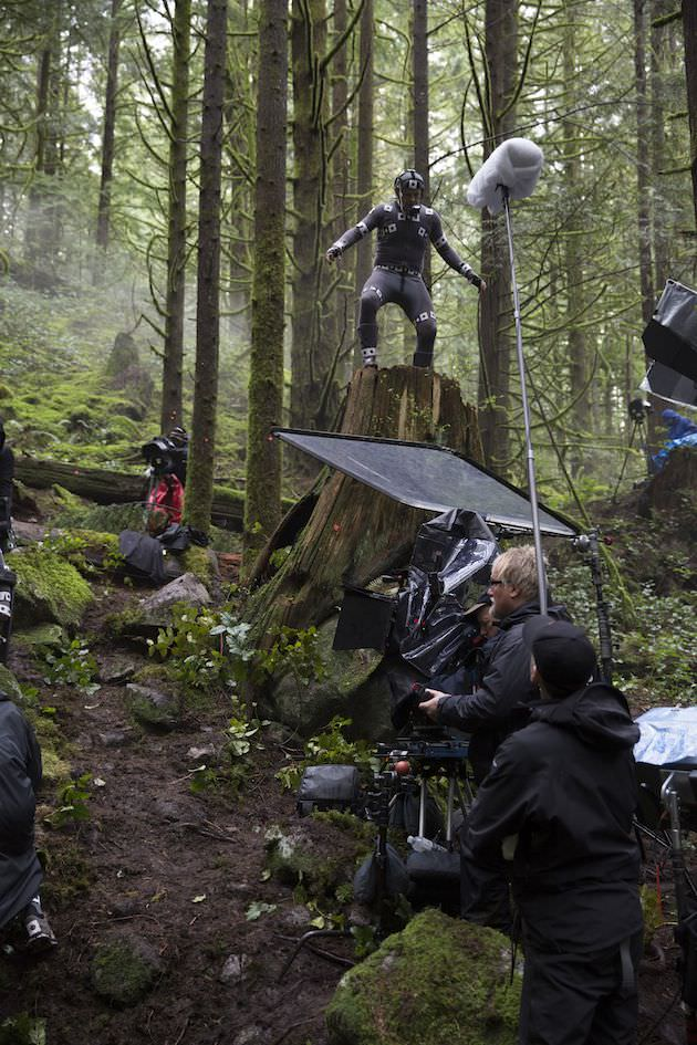 Caesar, portrayed by Andy Serkis in a performance capture suit, asserting his dominance in a rainforest near Vancouver. Courtesy 20th Century Fox.