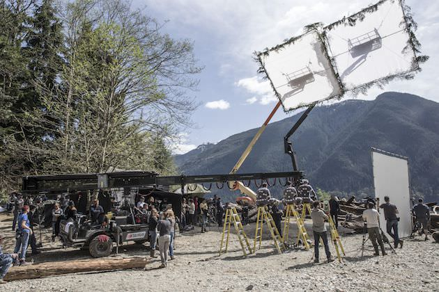 The film crew sets up their shot on the edge of the forest. Courtesy 20th Century Fox.