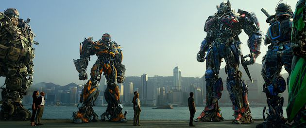 Left to right: Hound, Bingbing Li plays Su Yueming, Stanley Tucci plays Joshua Joyce, Bumblebee, Jack Reynor plays Shane Dyson, Nicola Peltz plays Tessa Yeager, Mark Wahlberg plays Cade Yeager, Optimus Prime, Drift, and Crosshairs in TRANSFORMERS: AGE OF EXTINCTION, from Paramount Pictures.