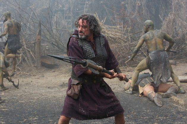 Ian McShane is Amphiaraus, with a Bessi warrior, and his tell tale diamondback tattoo created by Conor O'Sullivan, behind him. Courtesy Paramount Pictures.