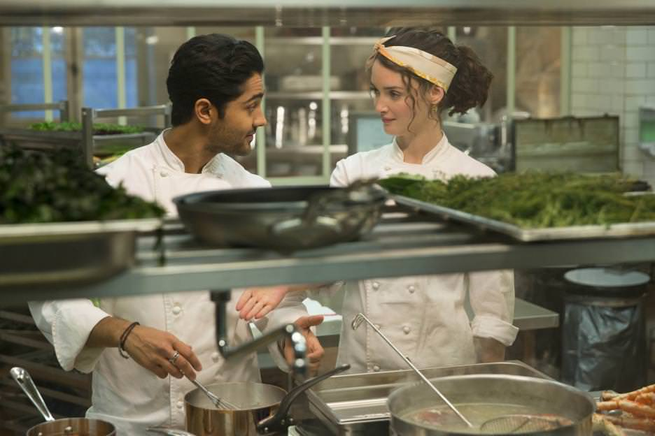 Hassan (Manish Dayal) and Marguerite (Charlotte Le Bon) are competitors who are finding more in common then they bargained for. Courtesy Walt Disney Studios.