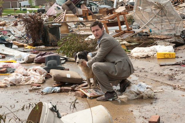Richard Armitage stars as Gary, a father of two standing amidst the rubble of what was once his neighborhood. Courtesy Warner Bros.