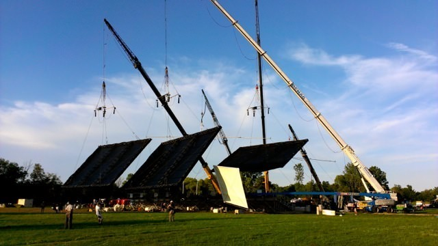 The cranes used to help block out the sun and filter the light onto the actors and scene. Courtesy Brian Pearson.