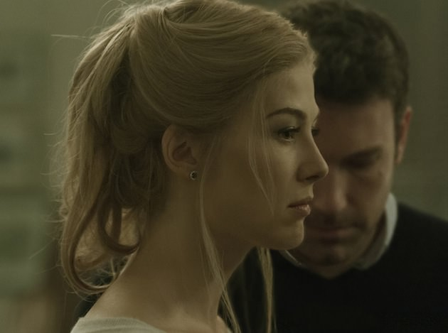 Rosamund Pike portrays Amy Dunne, whose mysterious disappearance turns her husband into a possible murder suspect.