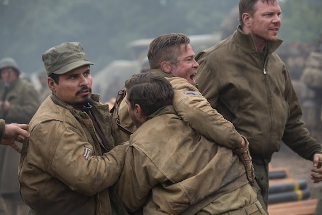"Trini ""Gordo"" Garcia (Michael Pena), Boyd ""Bible"" Swan (Shia LeBeaouf) and Sergeant Binkowski (Jim Parrack) try to hold back Wardaddy (Brad Pitt) as he attacks an SS Sergeant in Columbia Pictures' FURY."