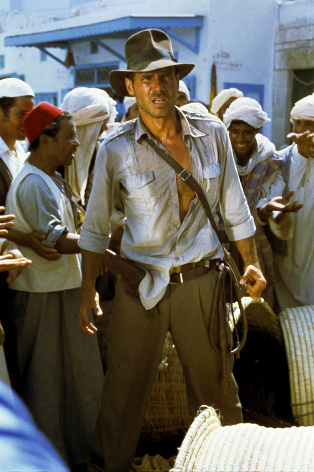 """Indiana Jones (Harrison Ford) in Raiders of the Lost Ark, 1981. """"Costume designer Deborah Nadoolman based the fedora on a model manufactured by Herbert Johnson on Savile Row, adjusting the crown and brim to flatter Ford's face."""" Courtesy 'Hollywood Costume' exhibit."""