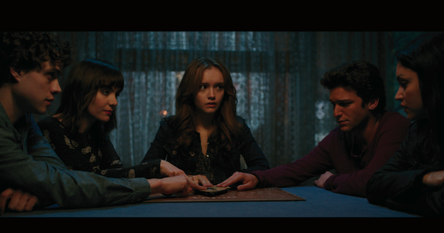 "(L to R) Pete (DOUGLAS SMITH), Sarah (ANA COTO), Laine (OLIVIA COOKE), Trevor (DAREN KAGASOFF) and Isabelle (BIANCA SANTOS) in ""Ouija"", a supernatural thriller about a group of friends who must confront their most terrifying fears when they awaken the dark powers of an ancient spirit board."