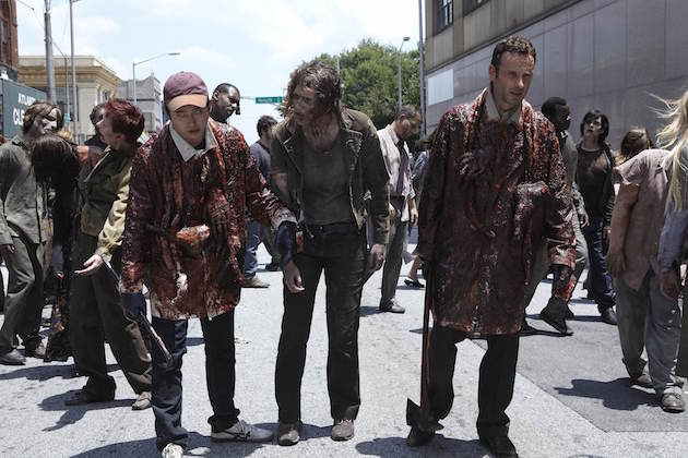 Rick and Glenn (Steven Yeun) go unnoticed by walkers thanks to the guts and limbs covering their body. Courtesy AMC.