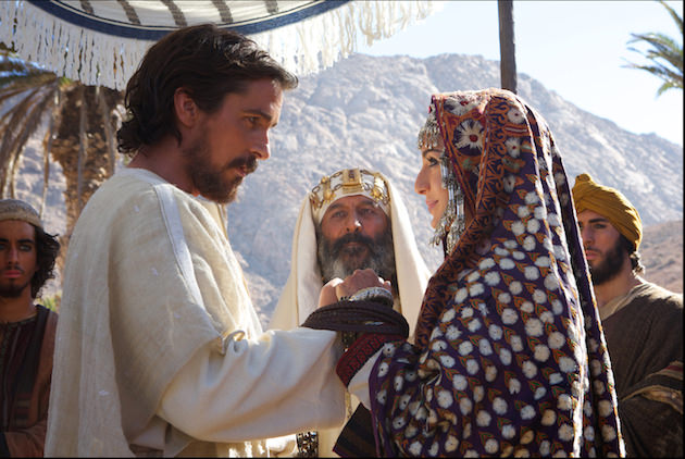 Moses (Christian Bale) weds Zipporah (María Valverde) with her father, Jethro (Kevork Mailkyan, center). Courtesy 20th Century Fox.