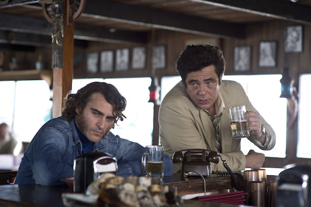 Doc and his attorney, Sancho Smilax, Esq (Benicio Del Toro). Courtesy Warner Bros. Pictures.