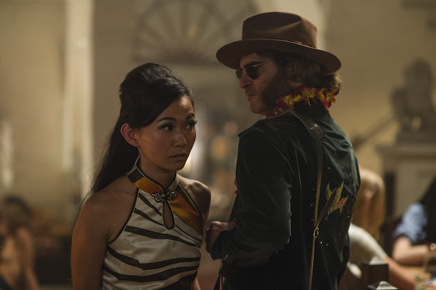 Jade (Hong Chou) wears a vintage dress bought in Chinatown. She speaks with Doc (Joaquin Phoenix), looking a little like a 1970s Neil Young. Courtesy Warner Bros. Pictures.