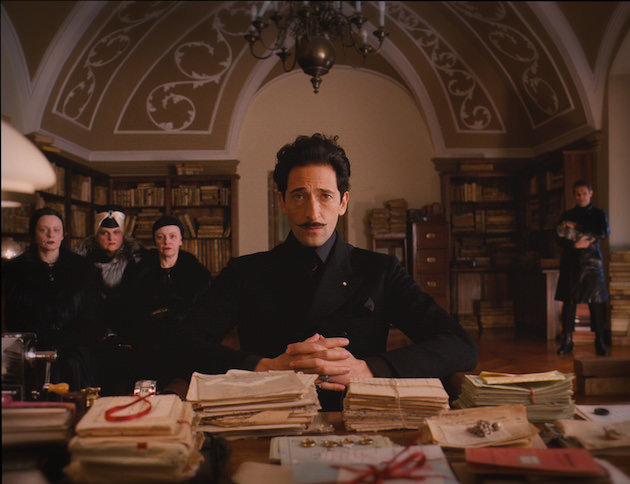 Adrien Brody, perfectly framed, with William Dafoe over his left shoulder. Courtesy Fox Searchlight Pictures.