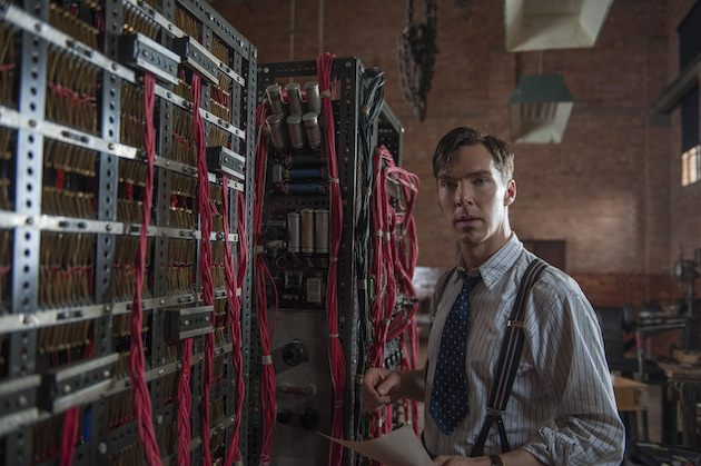 Alan Turing (Benedict Cumberbatch) stands in front of his codebreaking machine, 'Christopher,' which has a profusion of red wires for more than just practical reasons. Courtesy Weinstein Co.
