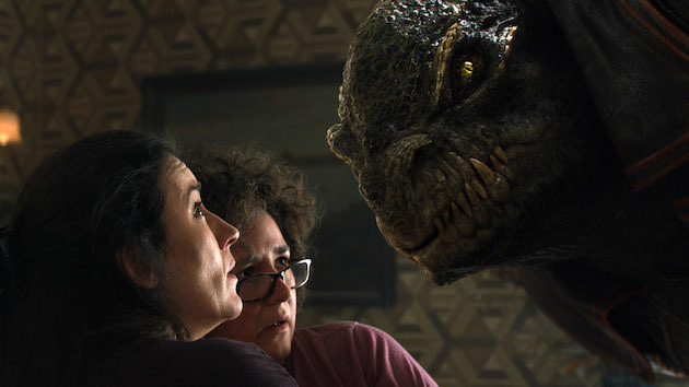 L-r:  Aleksa (Maria Doyle Kennedy), and Aunt Nino (Frog Stone) get a visit from Greeghan (Ariyon Bakare). Courtesy Warner Bros. Pictures.