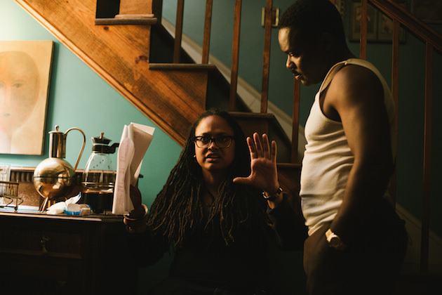 Left to right: Director/Executive Producer Ava DuVernay discusses a scene with David Oyelowo (as Dr. Martin Luther King, Jr.) on the set of SELMA, from Paramount Pictures, Pathé, and Harpo Films. SEL-10837