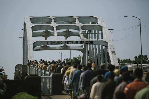 Marchers cross the Edmund Pettus Bridge in SELMA, from Paramount Pictures, Pathé, and Harpo Films. SEL-14596