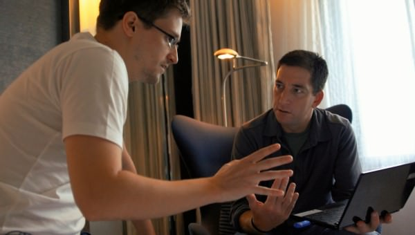 Snowden and journalist Glenn Greenwald in Snowden's hotel room in Hong Kong. Courtesy Raidus-TWC.