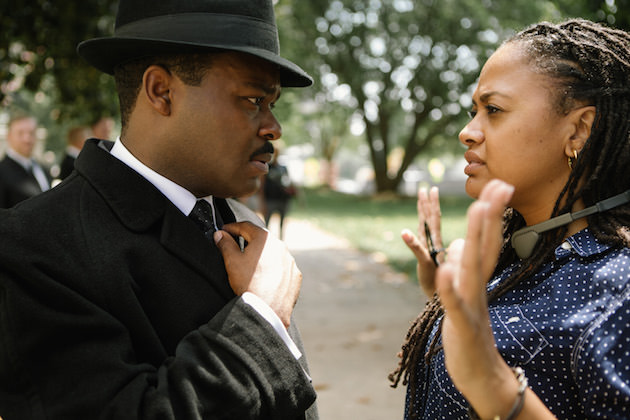 Left to right: David Oyelowo (as Dr. Martin Luther King, Jr.) discusses a scene with Director/Executive Producer Ava DuVernay on the set of SELMA, from Paramount Pictures, Pathé, and Harpo Films.