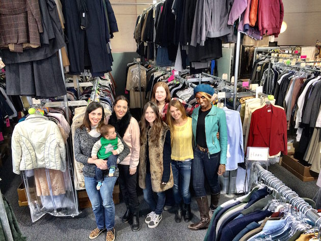 'The American's' costume department. (left to right) Katie Irish - Assistant Costume Designer (holding Desmond Chinn), Jenny Gering - Costume Designer, Bailey Gardner - PA, Sarah Moore - Tailor, Jenn O'Brien - Costume Coordinator, Liana John - PA