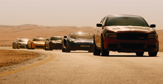 Among the fleet pictured are a black 2014 Dodge Viper for Letty (Rodriguez), Tej's yellow Ferrari, a blue McLaren P1 for Brian (Walker), and a white 2012 Bugatti Veryon for Roman (Gibson). Courtesy Universal Pictures.