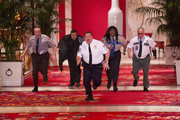 Paul Blart (Kevin James) with Gino Chizetti (Vic DiBitetto) , Khan Mubi (Shelly Desai), Donna Ericone (Loni Love) and Saul Gundermutt (Gary Valentine) take on the art thieves in the grand hallway in Columbia Pictures' PAUL BLART: MALL COP 2.