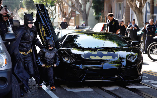 "Caption: (L-r) EJ JOHNSTON as Batman and MILES SCOTT as Batkid in New Line Cinema's documentary ""Batkid Begins,"" A Warner Bros. Pictures release."