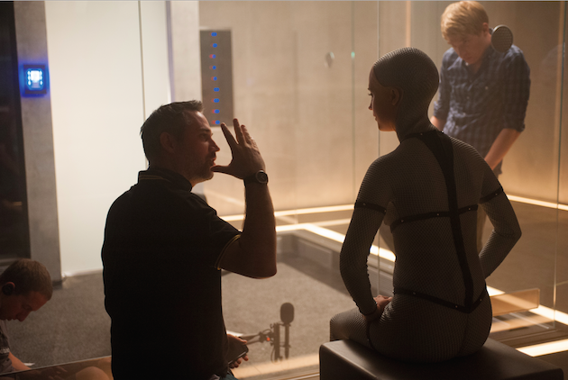 Writer/directorAlex Garland talks to Alicia Vikander, with Domhnall Gleeson in the background. Gleeson is the one in the fishbowl in Digby's design. Courtesy A24.