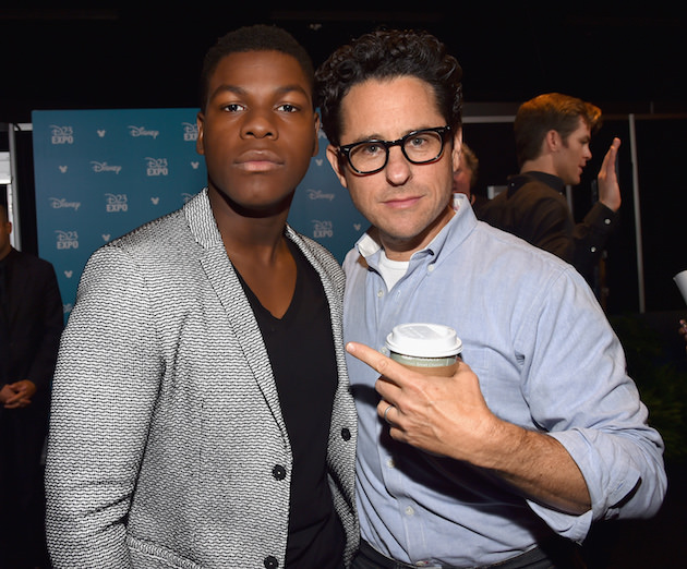 "ANAHEIM, CA - AUGUST 15: Actor John Boyega (L) and director J.J. Abrams of STAR WARS: THE FORCE AWAKENS took part today in ""Worlds, Galaxies, and Universes: Live Action at The Walt Disney Studios"" presentation at Disney's D23 EXPO 2015 in Anaheim, Calif.  (Photo by Alberto E. Rodriguez/Getty Images for Disney) *** Local Caption *** John Boyega; J.J. Abrams"