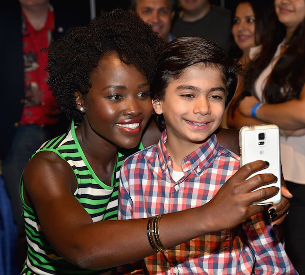 "ANAHEIM, CA - AUGUST 15: Actors Lupita Nyong'o (L) and Neel Sethi of THE JUNGLE BOOK took part today in ""Worlds, Galaxies, and Universes: Live Action at The Walt Disney Studios"" presentation at Disney's D23 EXPO 2015 in Anaheim, Calif.  (Photo by Alberto E. Rodriguez/Getty Images for Disney) *** Local Caption *** Lupita Nyong'o; Neel Sethi"
