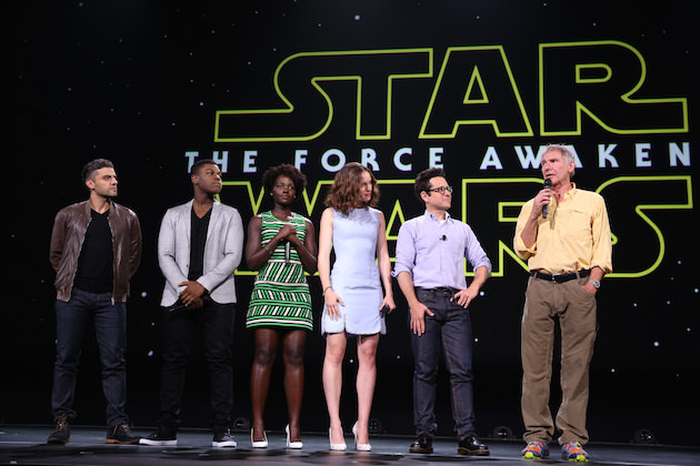 "ANAHEIM, CA - AUGUST 15:  (L-R) Actors Oscar Isaac, John Boyega, Lupita Nyong'o, Daisy Ridley, director J.J. Abrams and actor Harrison Ford of STAR WARS: THE FORCE AWAKENS took part today in ""Worlds, Galaxies, and Universes: Live Action at The Walt Disney Studios"" presentation at Disney's D23 EXPO 2015 in Anaheim, Calif.  (Photo by Jesse Grant/Getty Images for Disney)"